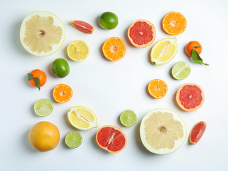 Different citrus fruits on white background, flat lay. Space for text