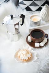 Cozy white winter home arrangement on windowsill, coffee and swe