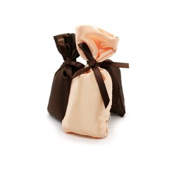 Silk gift bags with bow isolated on white.