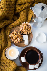 Warm home arrangement on windowsill, coffee and cookies with can