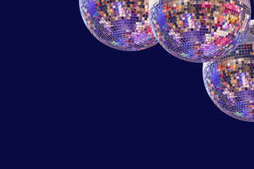 Large disco balls on a blue monophonic background.