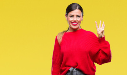 Young beautiful business woman wearing winter sweater over isolated background showing and pointing up with fingers number four while smiling confident and happy.