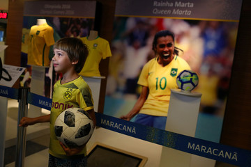 "A boy stands in front of Brazil's soccer player Marta Vieira da Silva photo in Maracana's ""Hall of Fame"" in Rio de Janeiro"