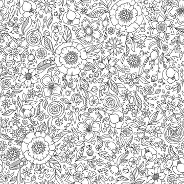 Seamless floral doodle background pattern in vector.