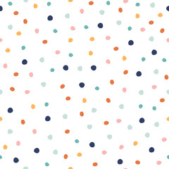 Seamless pattern with colorful dots. Confetti holiday print. Vector hand drawn illustration.