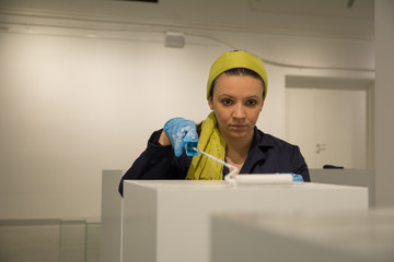 Young curator of the museum preparing space for hers first exhibition