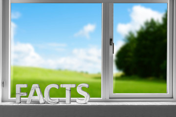 Facts decor sign in a window with a green meadow