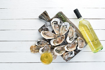 Fresh oysters with ice and white wine. Seafood. Top view. Free copy space.