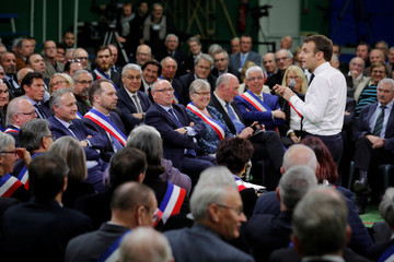 """French President Emmanuel Macron speaks during a meeting with mayors from rural Normandy as part of the launching of the """"Great National Debate"""" in Grand Bourgtheroulde"""