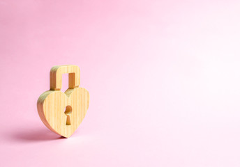 Padlock in the shape of a heart on a pink background. The secret of relationships and pickup rules. The concept of female intimate health. Strong love affair. Secrets, rumors and gossip.