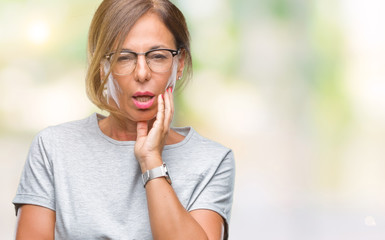 Middle age senior hispanic woman wearing glasses over isolated background thinking looking tired and bored with depression problems with crossed arms.