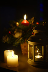 a few candles and pine decoration