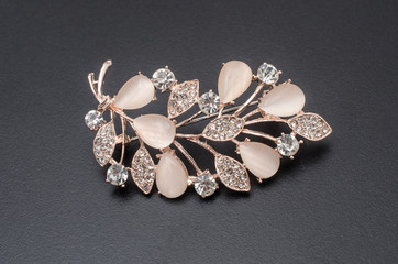 Wall Mural - golden brooch twig with moonstones and diamonds isolated on black