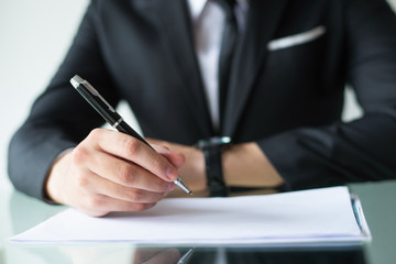 Company owner signing contract. Closeup of businessman writing in documents. Business meeting concept