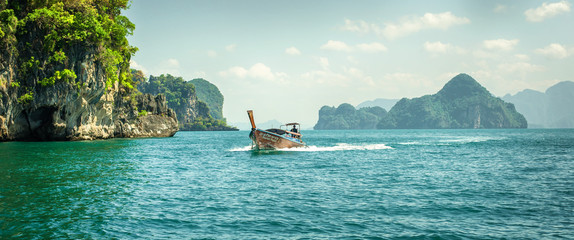 Traditional long tail boat at koh Hong island Wall mural