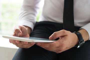 Man using mobile computer. Closeup of tablet in businessman hands. Business app concept