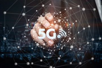 A businessman is touching the networking sphere with 5G and free internet symbols inside.