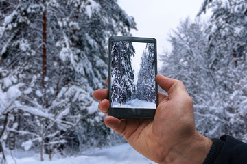 photo shooting on smartphone during a winter walk