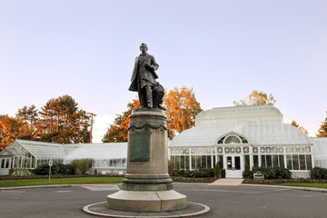The sculpture William Henry Seward in front of the Volunteer Park Conservatory