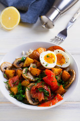 Smoked salmon breakfast bowl with egg, potatoes, mushrooms and rice