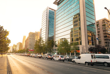 Apoquindo Avenue and modern buildings of Las Condes neighborhood at sunset - Santiago, Chile