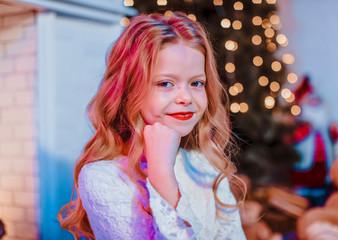 Small girl. Christmas background