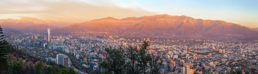 Panoramic aerial view of Santiago skyline at sunset with Andes Mountains - Santiago, Chile