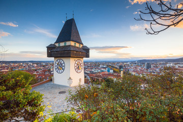 Deurstickers Centraal Europa Graz clock tower at sunset, Graz, Styria, Austria
