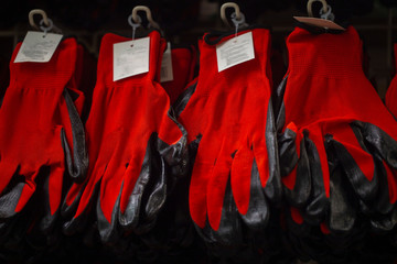 red construction gloves on the shelf in the hardware store Wall mural