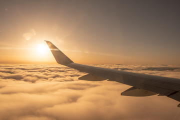 View flying above the clouds at sunset
