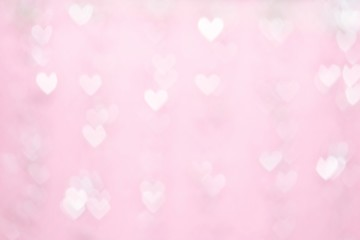 Bokeh background, pink heart shape. Valentines Day