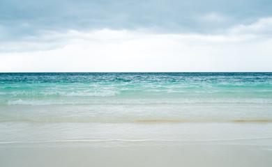 Empty sea, beach and cloudy sky