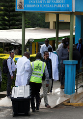 Kenyan police crimes scene experts arrive at the Chiromo mortuary to assess the dead bodies recovered from the scene where explosions and gunshots were heard at the Dusit hotel compound, in Nairobi