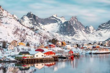 Colorful scandinavian village with snow mountain on coastline