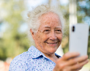 Sweet senior woman taking a selfie