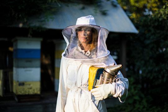 Beekeeper posing with the smoker