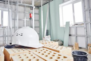 Home repairs. Construction tools, bricks and helmet