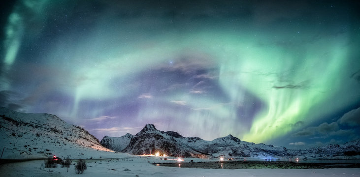 Northern lights explosion on snowy mountain range