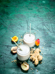 Milk smoothie with peaches and ginger.