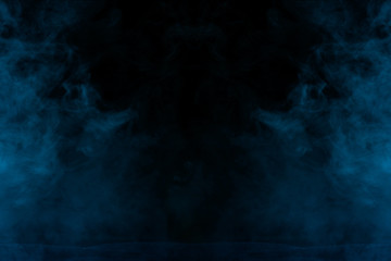mysterious blue vapor on a dark background thick and transparent