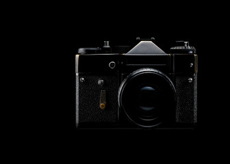 vintage black film camera on black background