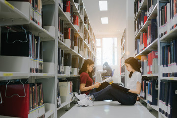 Young Asian women reading a book in library.Education Concept