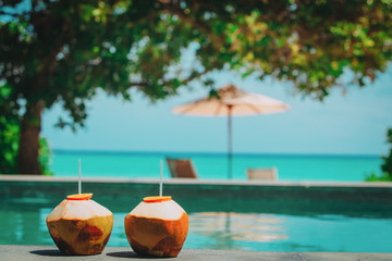 two coconut drinks on tropical beach resort