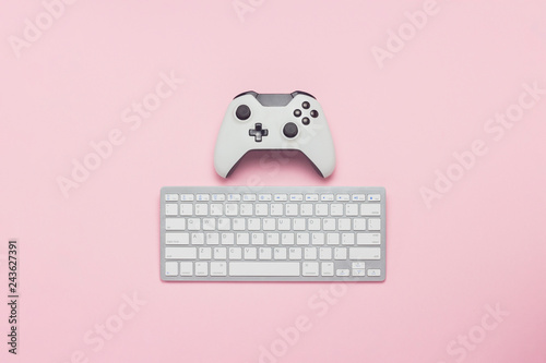 White gamepad and keyboard on a pink background  Tactics of the game