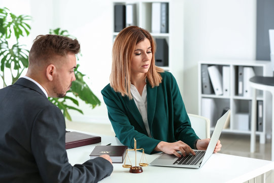 Female lawyer working with client in office