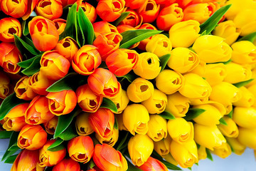 Colorful decorative artificial tulips, market stall. Selective focus