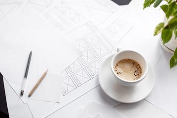 UX website designer drawing wireframe sketch of prototype, framework, layout future project. Creative user experience concept website template. Designer workspace