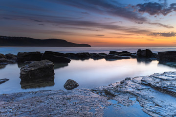 Dawn, Rocks, Reflections and Wispy Clouds Seascape