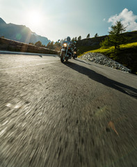 Motorcycle driver riding in Alpine highway, Hochalpenstrasse, Austria, Europe.