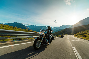 Motorcycle driver riding in Alpine highway, Hochalpenstrasse, Austria, Europe.